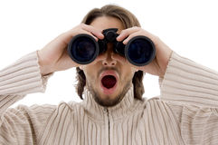 Astonished male watching through binocular Royalty Free Stock Images