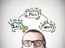 Astonished man and his business plan royalty free stock photo