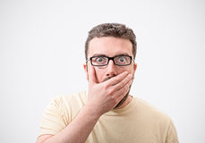 Astonished man with surprised facial expression Stock Photography