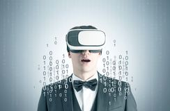 Astonished man in VR glasses, zeros and ones Royalty Free Stock Images