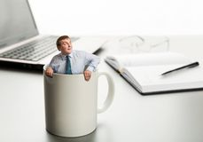 Astonished man in white cup. Surprised man in cup on laptop background Royalty Free Stock Image