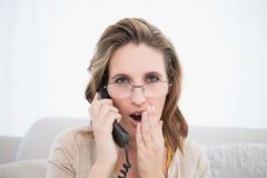 Astonished pretty woman having a phone call Stock Photo