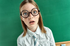 Astonished pupil staring at you with her mouth open Stock Image