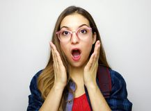 Astonished student receiving surprising news. Studio portrait on white background stock images