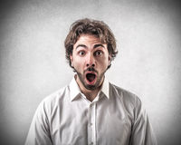 Astonished surprised young man royalty free stock image
