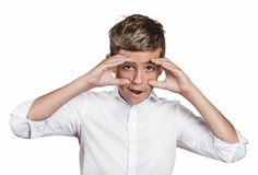 Astonished teenager. Handsome man looking shocked Stock Images