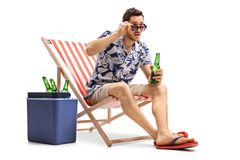 Astonished Tourist With A Beer Bottle Sitting In A Deck Chair An Stock Photography