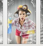 Astonished vintage housewife. Astonished housewife with gloves and detergent spray Royalty Free Stock Photos