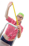 Astonished woman holding meter. Isolated on white. Surprised female worker ready for home renovating Stock Images