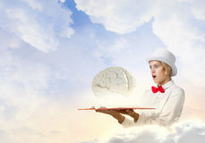 Astonished woman looking in book Royalty Free Stock Images