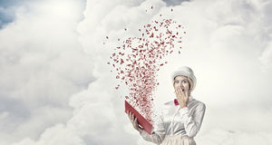 Astonished woman looking in book Stock Image