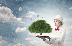 Astonished woman looking in book Royalty Free Stock Photo