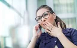 Astonished woman on phone Stock Photos