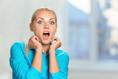 Astonished woman Stock Images