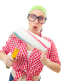 Astonished woman with roller ready for wall painting Stock Photography