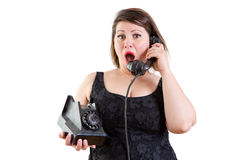 Astonished woman talking on a telephone Stock Images