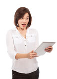 Astonished woman and touchpad Royalty Free Stock Image