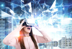 Astonished woman in VR glasses in a city, polygons Royalty Free Stock Photo