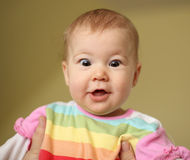 Astonished young baby Royalty Free Stock Photo