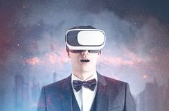 Astonished businessman in VR glasses, city sky Royalty Free Stock Photos