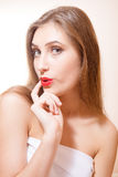 Astonished young female with her finger on lips Royalty Free Stock Images