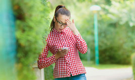 Astonished young girl with phone Stock Photo