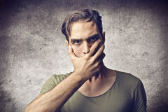 Astonished young man Stock Images