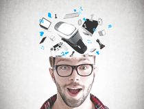 Astonished young man and gadgets Stock Images