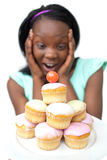 Astonished young woman looking at cakes Stock Photos