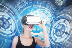 Astonished girl in VR glasses futuristic interface Stock Image