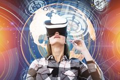 Nerd woman in VR glasses, global network interface Royalty Free Stock Photo