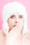 Astonished young woman wearing a white fur hat Royalty Free Stock Photo