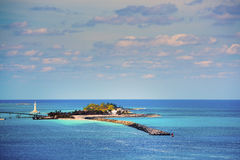 Astonishing islet with a lighthouse Royalty Free Stock Photography