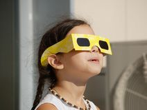 Astonishing little girl. Who's looking solar eclipse Royalty Free Stock Images