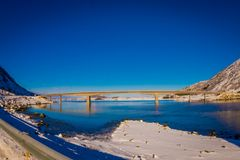 Astonishing outdoor view of Gimsoystraumen Bridge is a cantilever road that crosses the strait between the islands of. Austvagoya and Gimsoya in a beautiful Royalty Free Stock Image