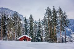 Astonishing outdoor view of traditional Norwegian mountain red houses of wood covered with snow in the roof in stunning. Nature background in Norway Stock Photo