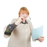 Astonishing senior woman reading a paper Royalty Free Stock Photography