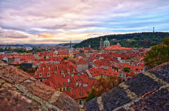 Astonishing sunset with view to old Prague, Czech Republic. Beautiful October sunset under old city of Prague Royalty Free Stock Photos