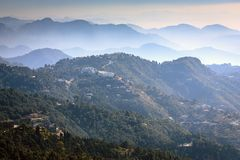 Astonishing view from Mussoorie mall road. Astonishing view of rolling mountains and the valley as seen from Mussoorie mall road Royalty Free Stock Photo
