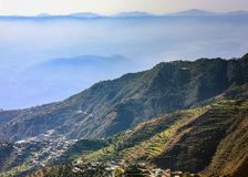 Astonishing valley view from Mussoorie mall road. Astonishing view of the valley as seen from Mussoorie mall road. Houses, resorts, winding roads and terrace Stock Photos