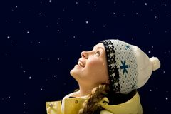 Astonishment. Portrait of amazed girl looking at falling snowflakes Royalty Free Stock Photography