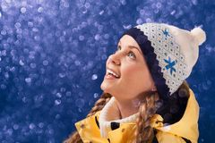 Astonishment. Portrait of amazed girl looking at sparkling snowfall Stock Photos