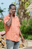 Astonishment phone. His camp, this young man called to the village and he was surprised by a information Stock Photography