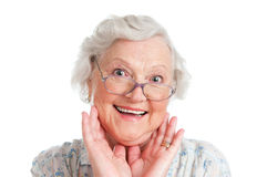 Astonishment and surprise. Happy surpised senior woman looking at camera isolated on white background Stock Photos