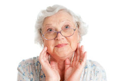Astonishment and surprise. Happy surprised senior lady looking up isolated on white background Stock Image