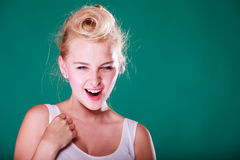 Astonishment young woman with pin up hair Stock Image