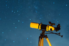 Astonomical Telescope Pointed at the Starry Sky. In the Night Stock Photos