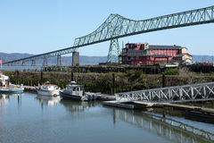 The Astoria bridge & old cannery hotel. Royalty Free Stock Photo