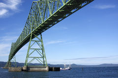 The Astoria Bridge & a passing boat. The Astoria Bridge and a passing fishing boat Stock Images