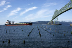 Astoria bridge and a passing ship. The Astoria bridge and a passing cargo ship Stock Image